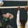 Missouri Southern's Morgan Nash (5) spikes the ball as Cameron's Caitlyn Henderson (12) defends during their match on Saturday at Leggett & Platt.<br /> Globe | Laurie Sisk