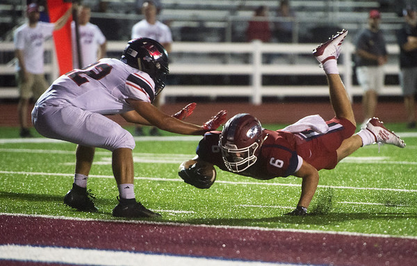Joplin's Nathan Glades is stopped a yard short of the goal by Branson's Brandt Sainato during Friday's game at Joplin.<br /> Globe | Roger Nomer