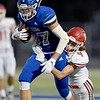 Carl Junction defensive back Mylas Derfelt 94) tries to bring down Carthage receiver Alex Martini (87) during their game on Friday night at Carthage.<br /> Globe | Laurie SIsk
