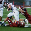 Joplin's Marcelino Puente (49) and Elijah Eminger (29) combine to tackle Branson's Stephen Derks during Friday's game at Joplin.<br /> Globe | Roger Nomer