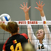 Missouri Southern's Olivia Lewis (12) tries to block a spike by Pittsburg State's Morgan Henning (14) during their match on Tuesday night at PSU.<br /> Globe | Laurie Sisk