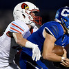 Webb City linebacker Ruben Lenker, left tries to bring down Carthage quarterback Patrick Carlton during their game on Friday night at Carthage High School.<br /> Globe | Laurie Sisk