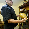 Former Green Bay Packer Nelson Toburen holds a football autographed by his team on Thursday at his Pittsburg home.<br /> Globe | Laurie Sisk