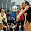 Pittsburg State's Erika Ivkov (11) returns a serve as teammate Marissa Bates (6) looks on during their match against Missouri Southern on Tuesday night at PSU.<br /> Globe | Laurie Sisk