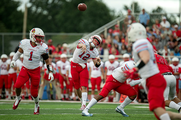 Webb  City's Kade Hicks(12) throws a pass as teamate Terrell Kabala looks on to defend his QB in Friday nights game against the Bulldogs in Carl Junction, Mo.