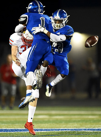 Carthage's Bobby Kendrick (1) blocks a punt by Webb City's xx as Marcus Huntley (13) prepares to recover the block during their game on Friday night at Carthage High School.<br /> Globe | Laurie Sisk