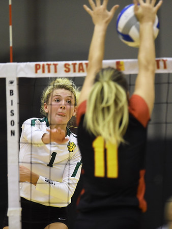 Missouri Southern's Morgan Nash (1) tries to get a spike past Pittsburg State's Erika Ivkov (11) during their match on Tuesday night at PSU.<br /> Globe   Laurie Sisk