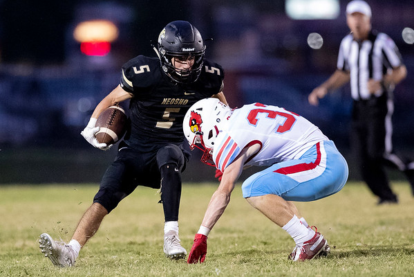 Neosho's Weston Durman runs the ball as he tries to get past Webb City's Jackson Taylor during Friday night's match against Webb City at Neosho High School.<br /> Globe|Israel