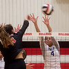 Carthage's Paige Schrader goes up for a block against Carl Junction during Tuesday's game at Carl Junction.<br /> Globe | Roger Nomer