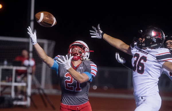Webb City's Shane Noel intercepts a pass meant for Branson's Colton Cooper in the end zone during Friday's game in Webb City.<br /> Globe | Roger Nomer