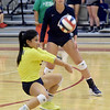 Joplin libero Jeanie Juneweeranong (31) returns a serve as teammate Aubrey Ritter (4) looks on during their match against Parkview on Tuesday night at Kaminsky Gymnasium.<br /> Globe | Laurie Sisk