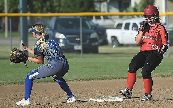 Carl Junction's Saedra Allen (20) makes her way to second base on a stand up double as Carthage's Karlee Kinder (7) fields the throw during their game on Tuesday at CJHS.<br /> Globe   Laurie Sisk