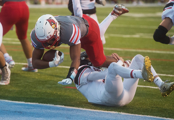 Webb City's Devrin Weathers gets away from Branson's Ty Werling to score during Friday's game in Webb City.<br /> Globe | Roger Nomer