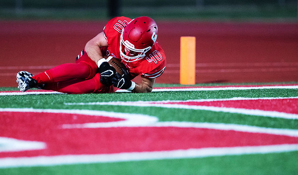 Bulldog's Hunter Hudson (40) recovers and holds on to the ball inside the end zone after blocking Ozark's punt during their Homecoming game on Friday evenining at Carl Junction High School.<br /> Globe|Israel Perez