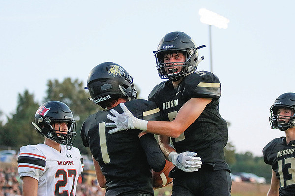 Neosho's Weston Durman (5) congratulates Gage Kelley (1) after he scores against Branson on Friday night at Bob Anderson Stadium.<br /> Globe | Jessica Greninger