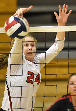 Carl Junction's Maggie Brown rises to block a Springfield Central spike during their match at the Dr. Jeffrey Knutzen CJ Classic on Saturday at Carl Junction High School.<br /> Globe   Laurie Sisk