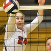 Carl Junction's Maggie Brown rises to block a Springfield Central spike during their match at the Dr. Jeffrey Knutzen CJ Classic on Saturday at Carl Junction High School.<br /> Globe | Laurie Sisk