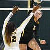 Missouri Southern's Shaylon Sharp (5) spikes the ball as Cameron's Caitlyn Henderson (12) defends during their match on Saturday at Leggett & Platt.<br /> Globe | Laurie Sisk