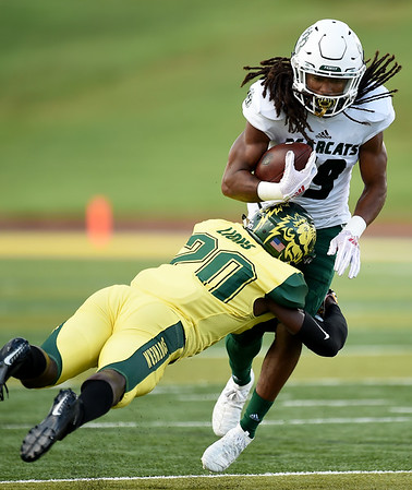 Missouri Southern's Malachi Broadnax (20) works to bring down Northwest Missouri State receiver Imani Donadelle (19) during their game on Saturday night at Fred G. Hughes Stadium.<br /> Globe | Laurie Sisk