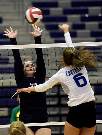 Joplin's Cassie Sharkey (20) tries to block a spike by Carthage's Addi Blagg (6) during their match on Tuesday night at Kaminsky Gymnasium.<br /> Globe | Laurie Sisk