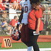 Joplin player Kaian Roberts Day gets a pregame hug from his mom, La Shanda Roberts Day on Saturday night at Webb City High School.<br /> Globe | Laurie Sisk