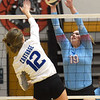 Webb City's nna Hettinger (19) blocks a spike by Carthage's Sydnee Dudolski (12) during the championship match at the Dr. Jeffrey Knutzen CJ Classic on Saturday at Carl Junction High School.<br /> Globe | Laurie Sisk