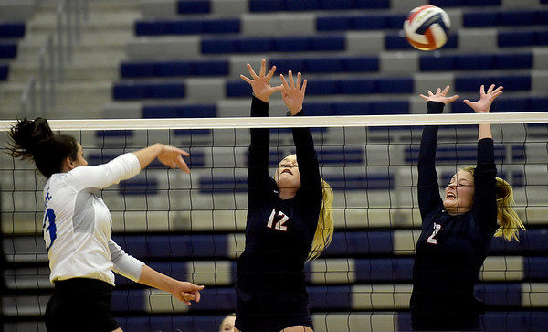 Carthage's Alexa Boyle (13) gets a spike past Joplin's Addison Saunders (12) and Angelina Schramm (2) during their match on Tuesday night at Kaminsky Gymnasium.<br /> Globe | Laurie Sisk