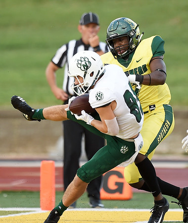 Northwest Missouri State receiver Alec Tatum (85) hangs onto a touchdown pass despite an interference call on Missouri Southern's Fontez Davis (17)  during their game on Saturday night at Fred G. Hughes Stadium.<br /> Globe | Laurie Sisk
