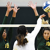 Missouri Southern's Kylee Kaaihue (18) and Alyssa Diaz (16) defend a dpike by Caneron's Arianna Navarette (11) during their match on Saturday at Leggett & Platt.<br /> Globe | Laurie Sisk