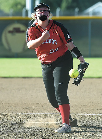Carl Juntion pitcher Jayden Green delivers a pitch to the plate during the Lady Bulldogs game against Carthage on Tuesday at CJHS.<br /> Globe | Laurie Sisk