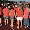 Joplin and Webb City football moms surround the Roberts Day family as they hold hands in prayer before the start of the JHS WCHS football game on Saturday night at Webb City High School.<br /> Globe | Laurie Sisk