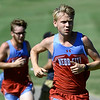 Webb City's xx nears the finish line as teammate xx tries to keep pace during the Carthage Invitational Cross Country meet on Thursday at the Carthage Municipal Golf Course.<br /> Globe | Laurie Sisk