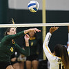 Missouri Southern's Alyssa Diaz (16)) logs a kill as Cameron's Caitlyn Henderson (12) attempts a block during their match on Saturday at Leggett & Platt.<br /> Globe | Laurie Sisk