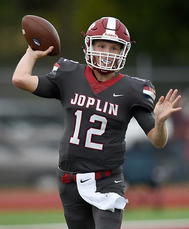 Joplin quarterback Blake Tash completes a pass to a receiver during the Eagles season opener against Willard on Friday night at Junge Stadium.<br /> Globe | Laurie Sisk