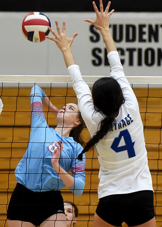 Webb City's Jasmine Putnam (8) goes p for a spike as Carthage blocker Paige Schrader (4) defends  during the championship match at the Dr. Jeffrey Knutzen CJ Classic on Saturday at Carl Junction High School.