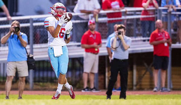 Webb City's Cohl Vanden catches the ball solo near the end zone during Friday night's game against Neosho Wildcats at Neosho.<br /> Globe|Israel Perez
