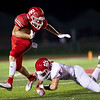 Bulldog's Garret Taylor (16) runs the ball as he breaks the tackle of Ozark's Ethan Pritchard during their Homecoming game on Friday evenining at Carl Junction High School.<br /> Globe|Israel Perez