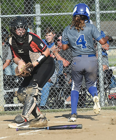 Carthage's Natalie Rodriguez (4) crosses the plate and gives the Tigers a 4-1 lead as Carl Junction catcher Allison Plumlee fields the throw during their game on Tuesday at CJHS.<br /> Globe | Laurie Sisk