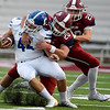 Joplin's Isaiah Davis (20) works to bring down Carthage's Kale Schrader (44) as Elijah Eminger (29) closes in during their game on Friday night at Junge Field.<br /> Globe | Laurie Sisk