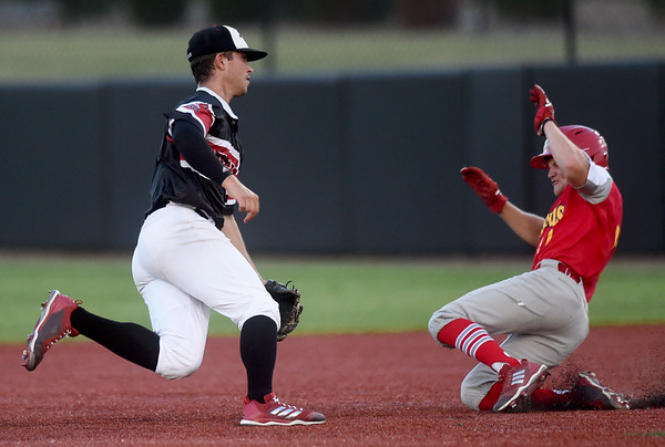 Joplin's Kaleb Delatorre chases after an errant throw as Springfield's XX XX (17) slides safely into second base on a steal during their non-league game on Wednesday night at Joe Becker Stadium.<br /> Globe | Laurie Sisk