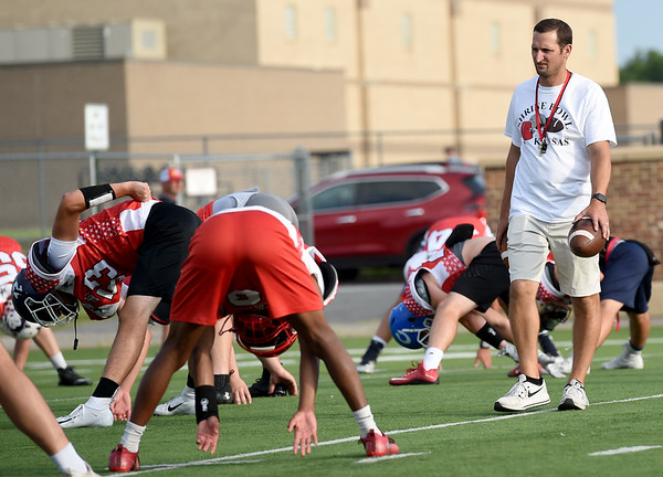 Frontenac Head Coach and former Shrine Bowl player Mark Smith warms up the East squad before practice on Thursday at Hutchinson Field.<br /> Globe | Laurie SIsk