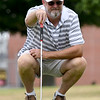 Paul Robinson, of Ozark, sizes up a putt during the first day of the Ozark Amateur on Saturday at Schifferdecker Golf Course. This year marks the 70th anniversary of the tournament.<br /> Globe | Laurie Sisk