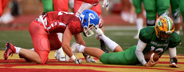 Colgan's Max Wilson brings down Braden Howell to stop a fourth down conversion attempt during the first quarter of the Kansas Shrine Bowl on Saturday night at Carnie Smith Stadium.<br /> Globe | Laurie Sisk