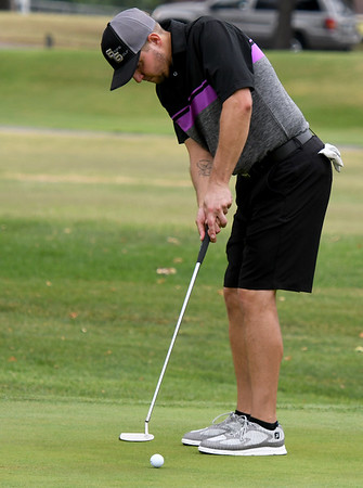Michael Frye, of Miami, putts during the first day of the Ozark Amateur on Saturday at Schifferdecker Golf Course. This year marks the 70th anniversary of the tournament.<br /> Globe | Laurie Sisk
