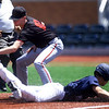 Midwest Nationals' Nick Olives slides under the tag of St. Louis Prospects thrid baseman H. McIntosh during thwir game in the Prep Baseball Report 4 State Regional on Saturday at Joe Becker Stadium.<br /> Globe | Laurie Sisk