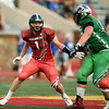 Frontenac's Brock Ginavan looks to get past Aaron Clark during the second quarter of the Kansas Shrine Bowl on Saturday night at Carnie Smith Stadium.<br /> Globe | Laurie Sisk