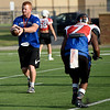 Colgan Head Coach Shawn Seematter runs part of the East squad through drills as they prepare for the Shrine Bowl on Thursday at Hutchinson Field.<br /> Globe | Laurie SIsk
