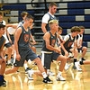Some of the top basketball players in the area stretch out Tuesday before drills at the Four States Elite Basketball Camp on Tuesday at Joplin High School. The invitation only camp featured some of the top 53 players in the area who are entering eight and ninth grades.<br /> Globe | Laurie Sisk
