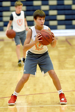 Soon-to-be eighthgrader Ky Warren, of Carl Junction, listens intently during drills at the Four States Elite Basketball Camp on Tuesday at Joplin High School. The invitation only camp features some of the top 53 players in the area who are entering eight and ninth grades.<br /> Globe | Laurie Sisk