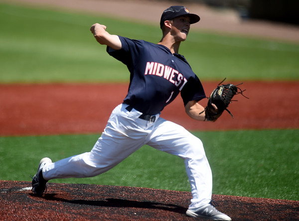 Midwest Nationals pitcher Mason Foley delivers a pitch to the plate against the St. Louis Prospects during the Prep Baseball Report 4 State Regional on Saturday at Joe Becker Stadium.<br /> Globe | Laurie Sisk